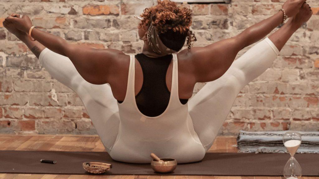 black woman smoking weed doing yoga cannaclusive